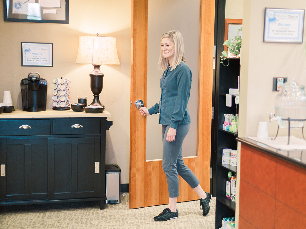 A patient walking in the door for treatment at Eugene Dental Group, in Eugene, OR