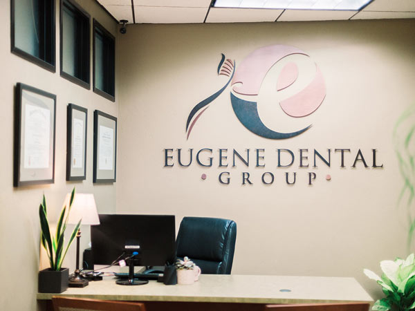 Dr. Vivona's desk with logo in the back at Eugene Dental Group, in Eugene, OR